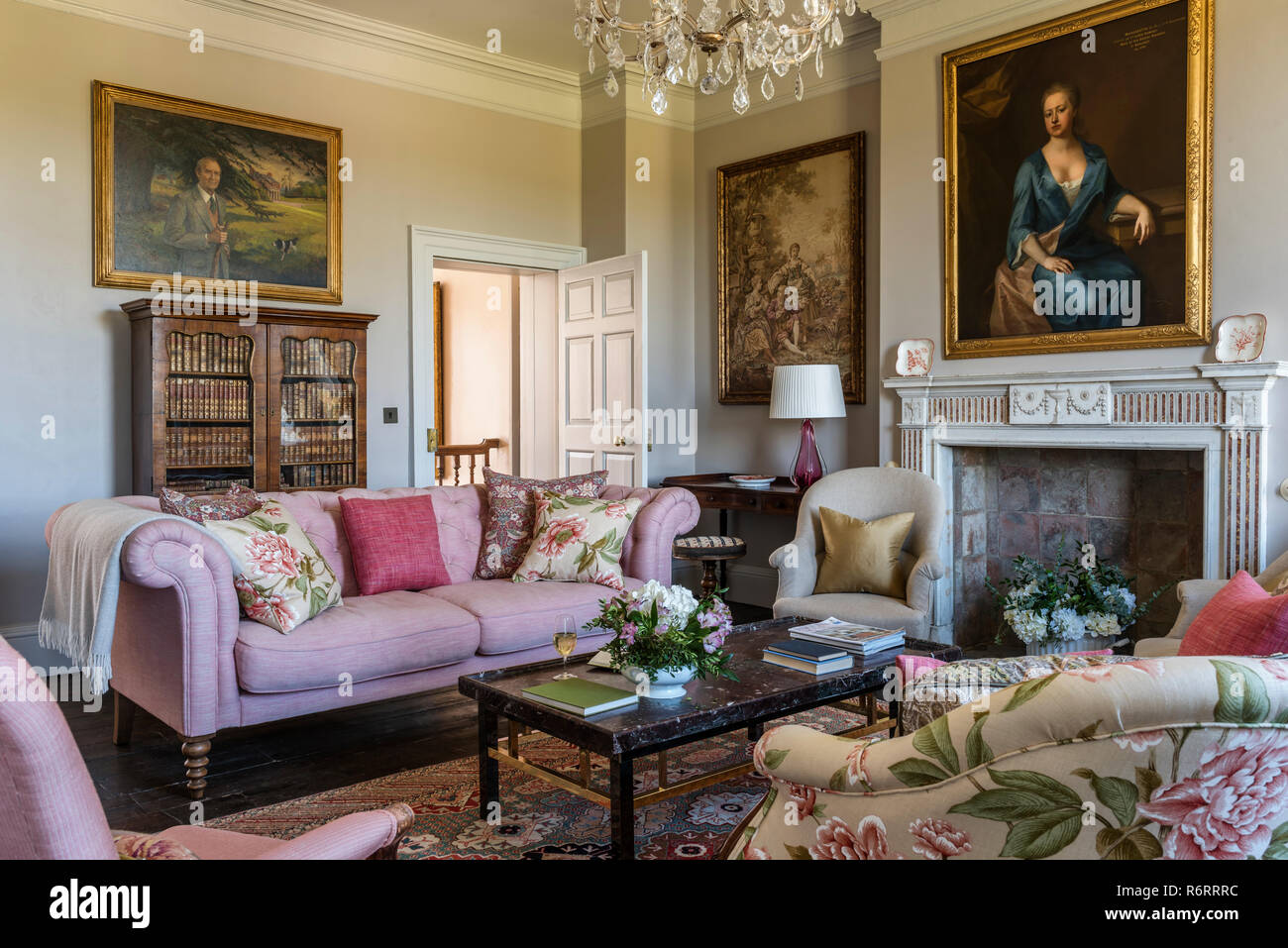 18th century Goodnestone estate Portrait of Fanny Fowler above fireplace in drawing room with pink sofa in 18th century Goodnestone mansion - Stock Image