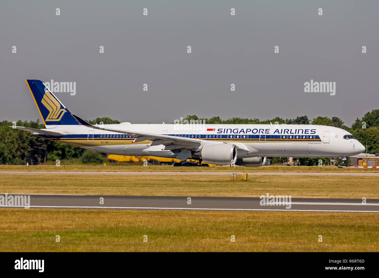 A Singapore Airlines Airbus A350, registration 9V-SMS taxying back to the terminal at manchester Airport in England. - Stock Image