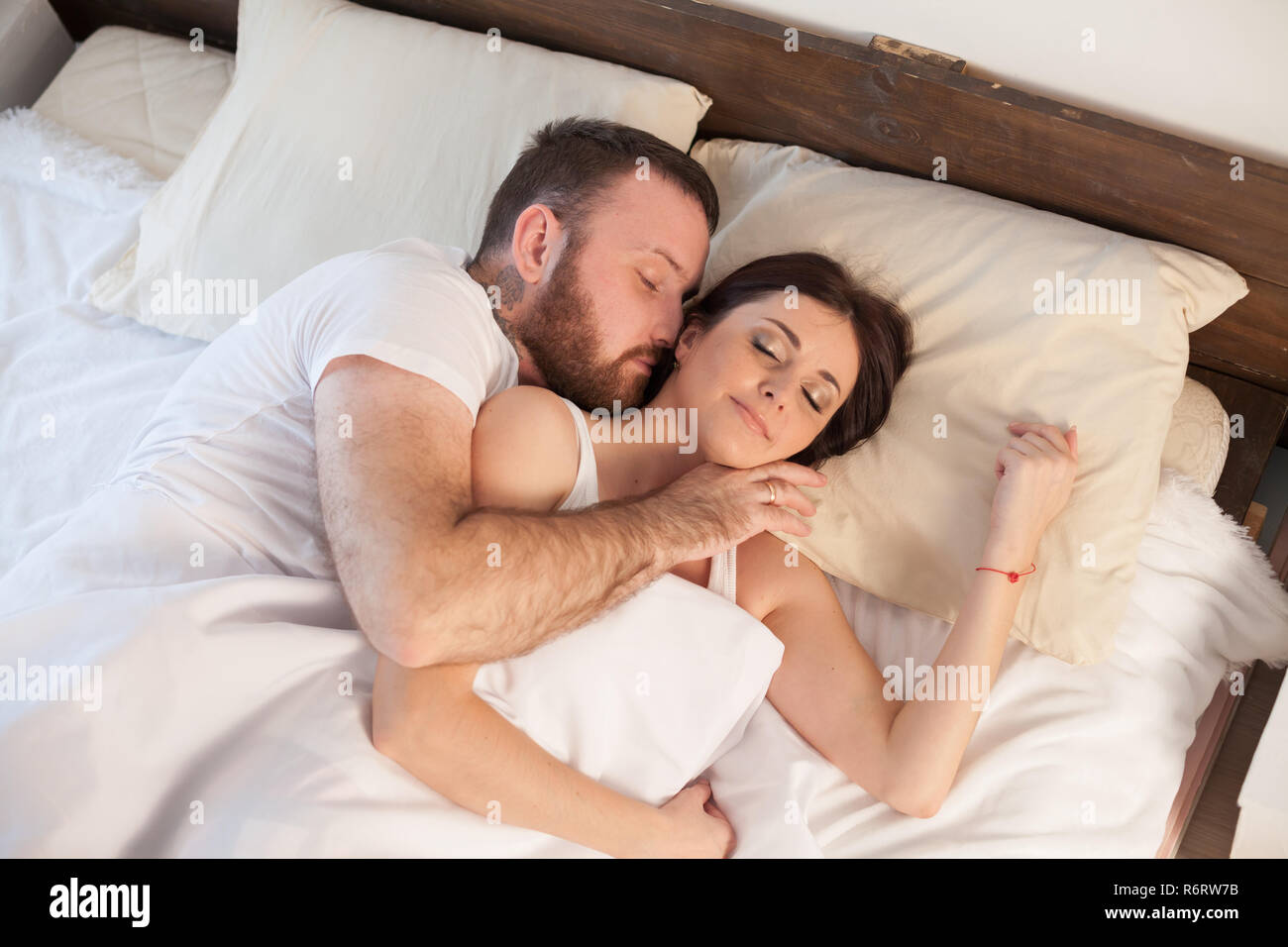 . husband and wife wake up in the morning in the bedroom of the