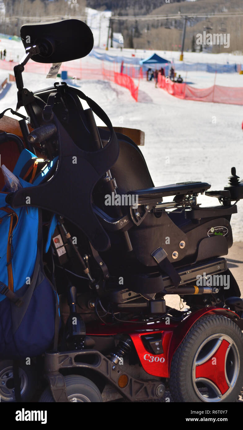 Athlete's empty electric wheelchair at Special Olympic alpine skiing event in Colorado - Stock Image