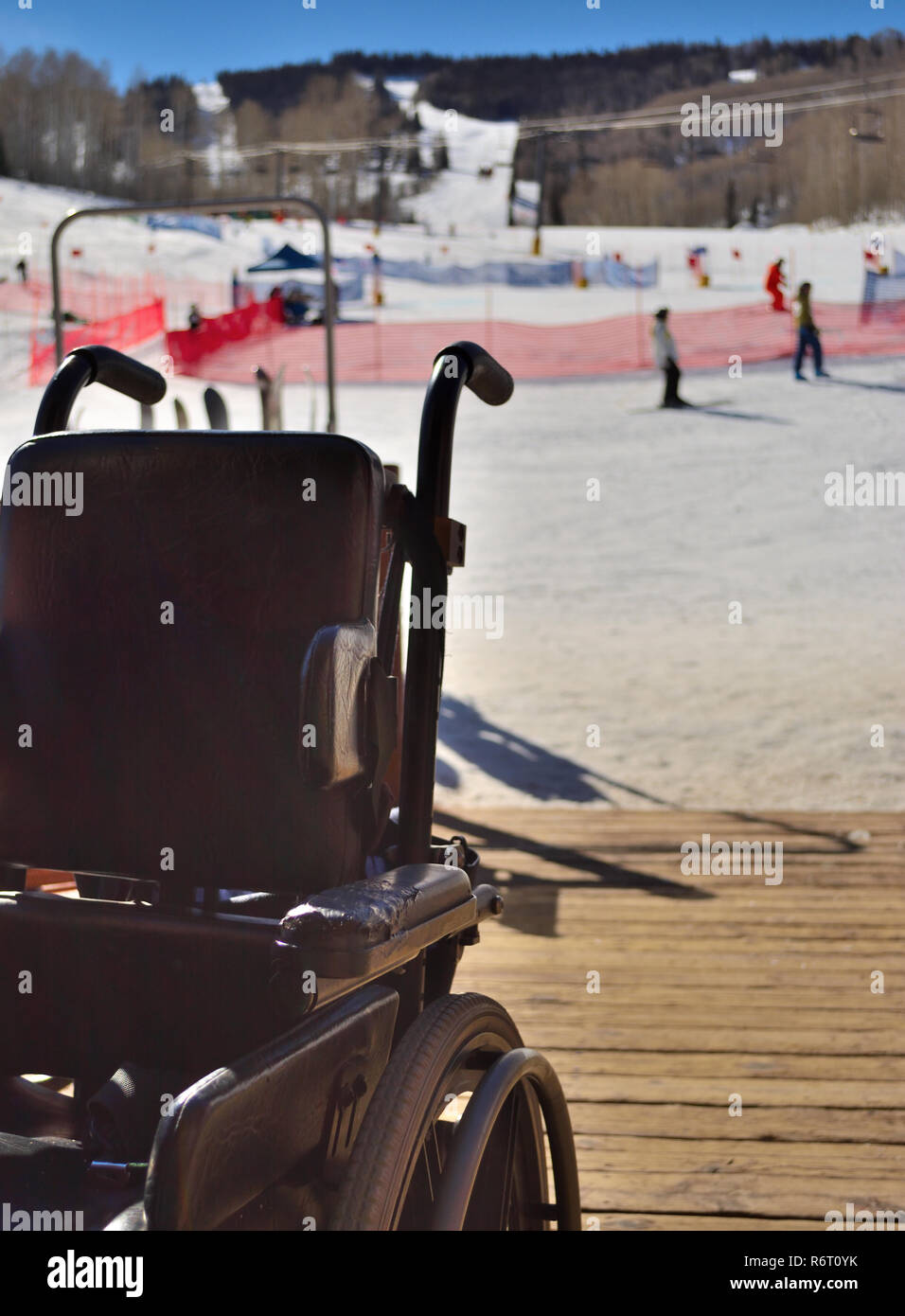Empty wheelchair at Colorado Special Olympics alpine skiing competition event - Stock Image