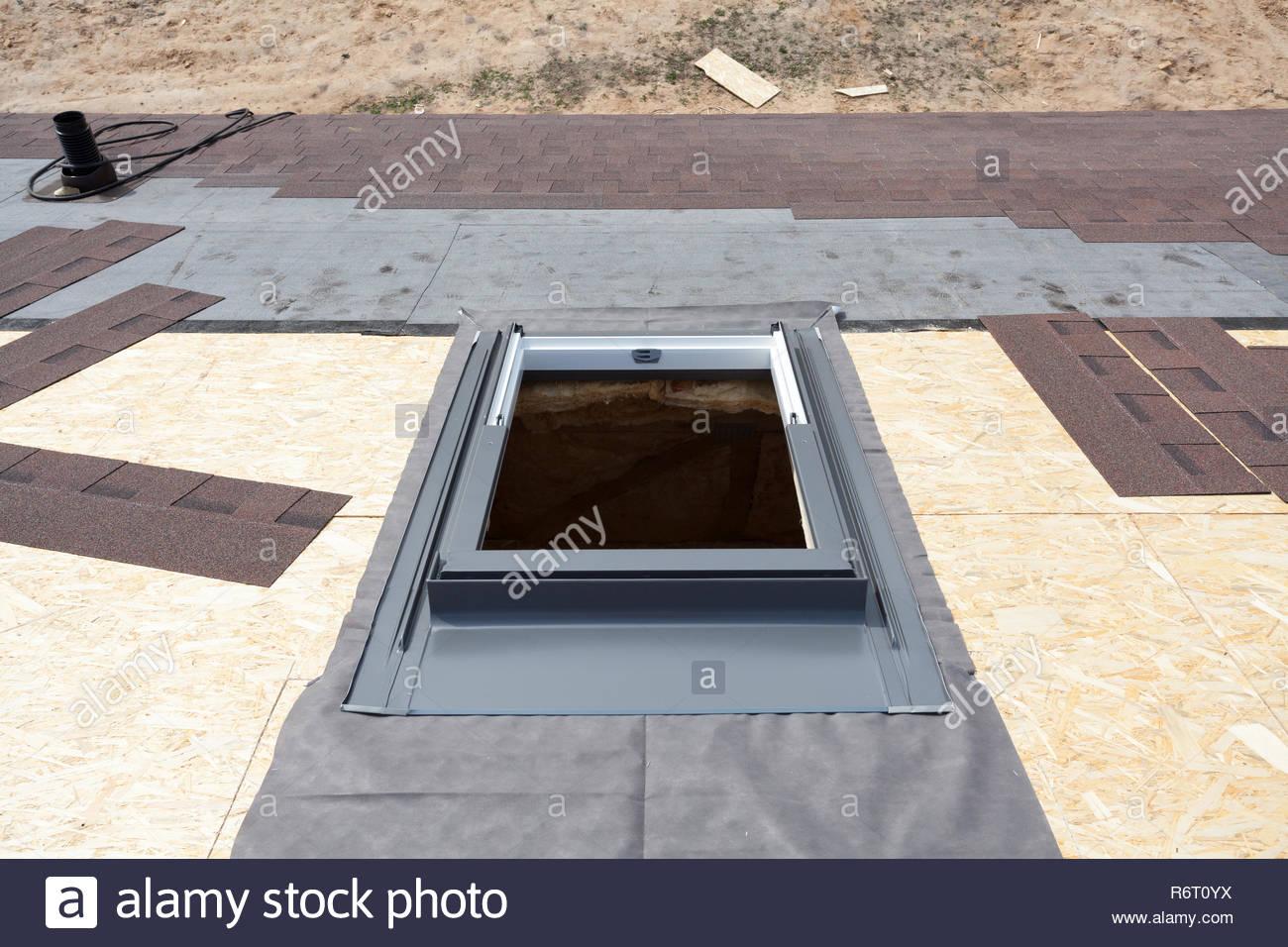 Installing Window Skylight On A Roof With Asphalt Shingles