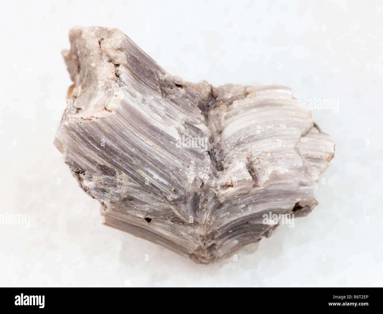 rough baryte stone on white marble - Stock Image