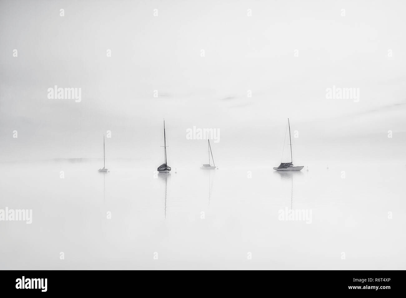 Ammersee Bavaria Sailboats in the morning at sunrise with fog - Stock Image