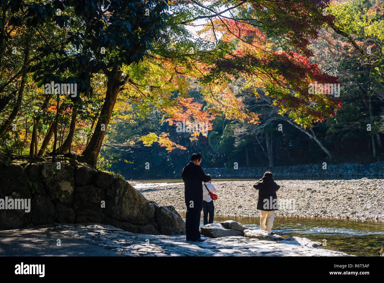 Ise Grand Shrine, Mie Prefecture, Japan: Pilgrims at Isuzu river, where ritual washings are done before entering the Inner Shrine (Naiku) - Stock Image