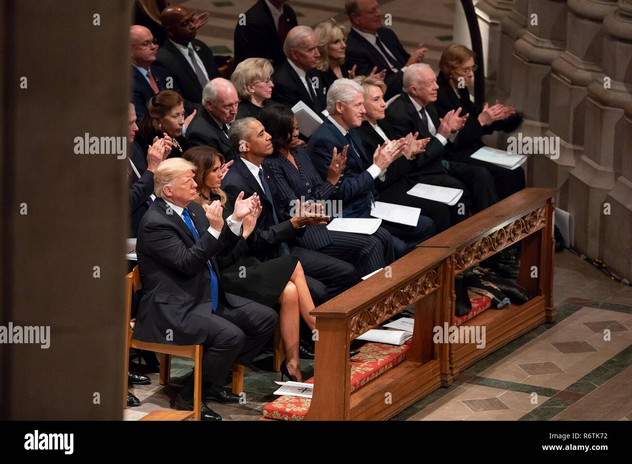 U.S. President Donald Trump and First Lady Melania Trump join former presidents and first ladies during the State Funeral for former president George H.W. Bush at the National Cathedral at the State Funeral December 5, 2018 in Washington, DC. Standing from left to right are: President Donald Trump, First Lady Melania Trump, President Barack Obama, First Lady Michelle Obama, President Bill Clinton, First Lady Hillary Clinton, President Jimmy Carter and First Lady Rosalynn Carter.  Bush, the 41st President, died in his Houston home at age 94. Stock Photo