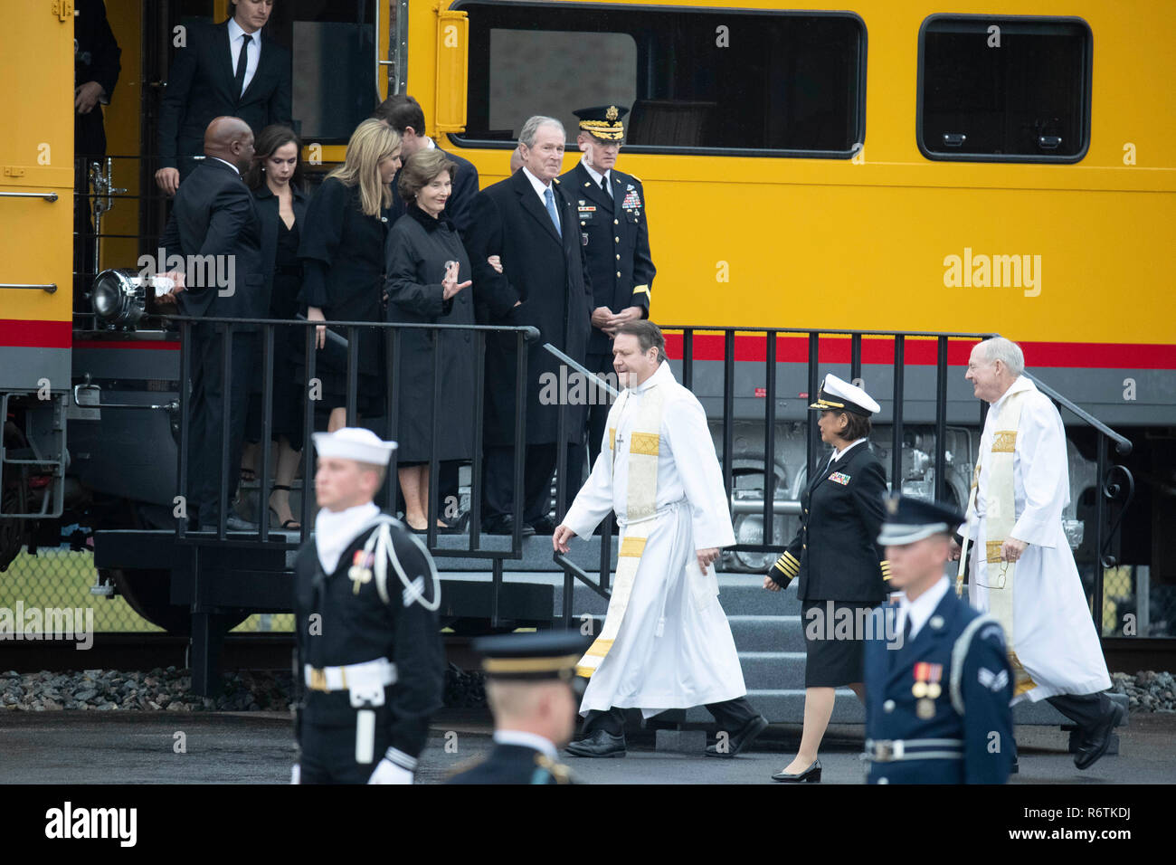 Former Pres. George W. Bush, wife Laura, and family step off train carrying the casket of Bush's father, former President George H.W. Bush, upon its arrival at Texas A&M University before burial at the nearby George Bush Library. Stock Photo
