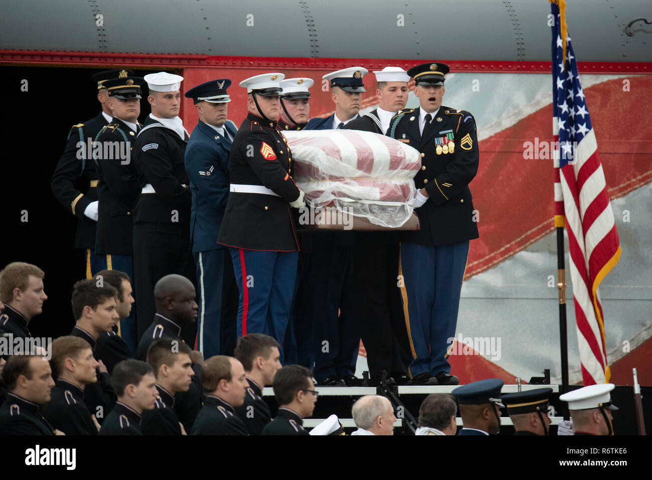 Military Honor Guard Pallbearers Carry The Casket Of Former