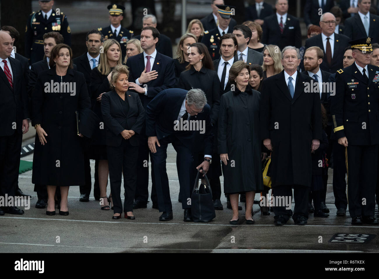 College Station, USA. 06th Dec, 2018. The casket containing the remains of former President George H.W. Bush arrives at Texas A&M University for a 20-minute ceremony before its final resting place at the George Bush Library. Bush passed away Nov. 30th in Houston. Credit: Bob Daemmrich/Alamy Live News - Stock Image