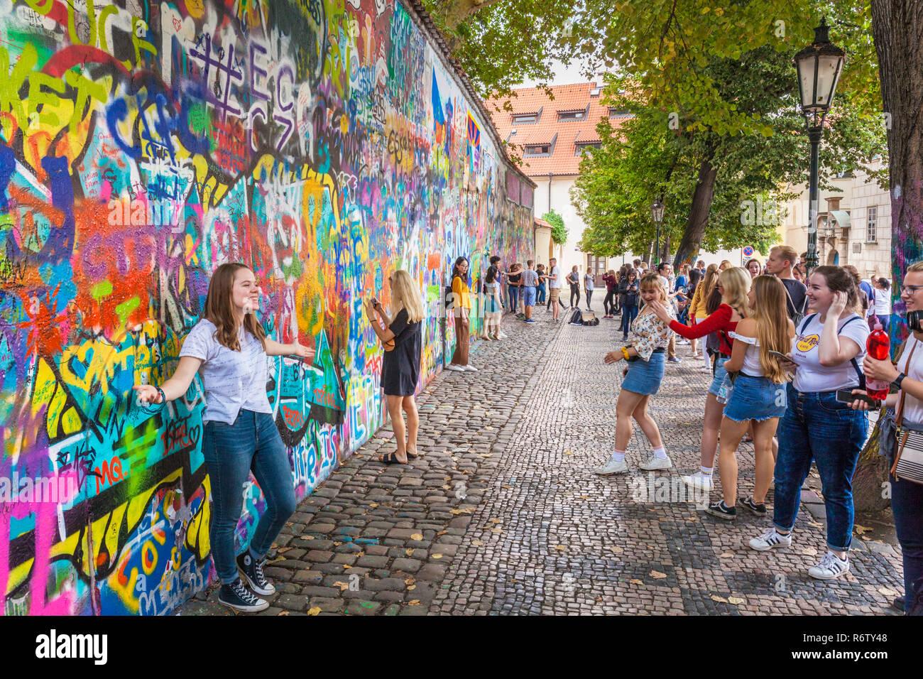 Lots of people taking photos at the Prague Lennon Wall Lennonova zeď Prague Velkopřevorské náměstí, Malá Strana Prague Czech Republic Europe - Stock Image