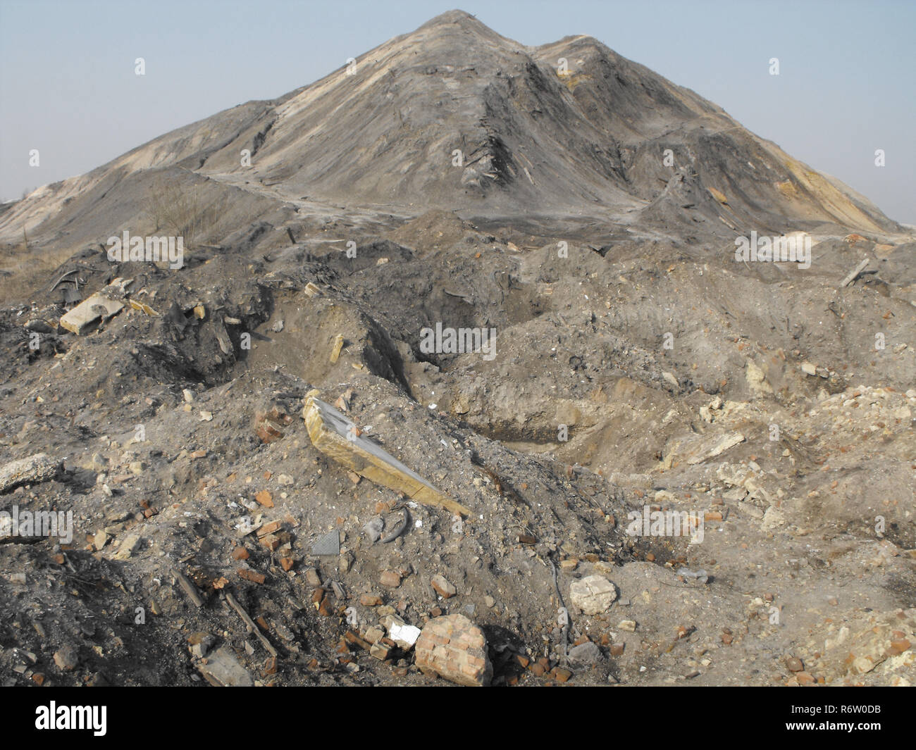 Ecological disaster, mountains of debris. - Stock Image