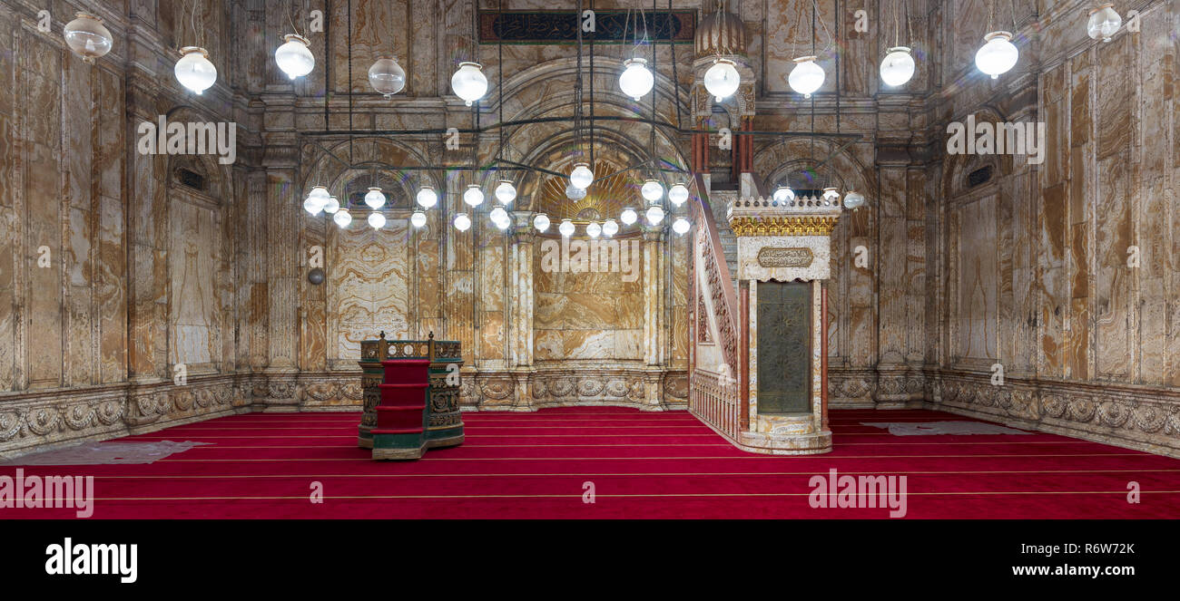 Decorated alabaster (marble) wall with engraved niche (Mihrab) and Platform (Minbar) at the great Mosque of Muhammad Ali Pasha (Alabaster Mosque) - Stock Image