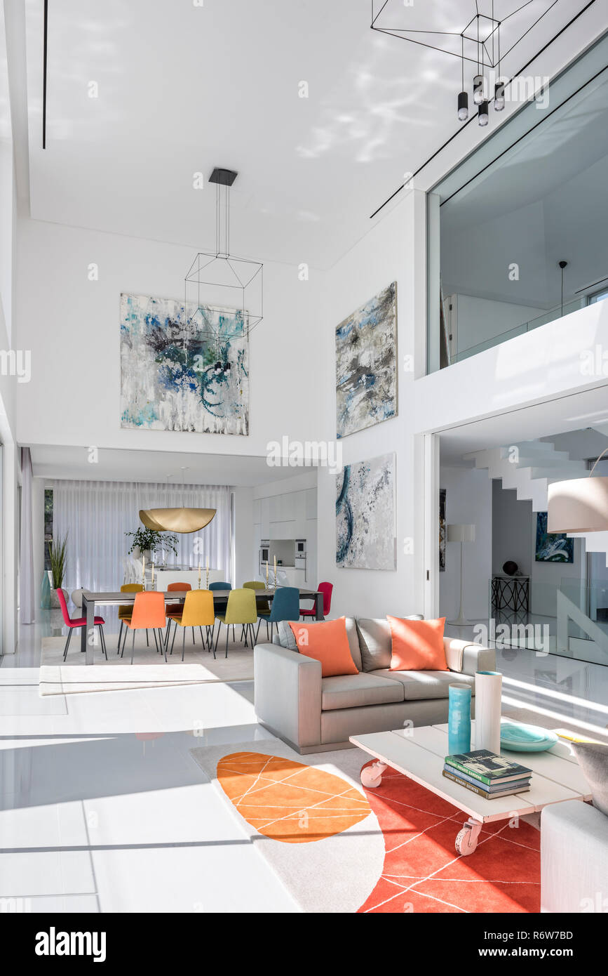 Double Height Living And Dining Room With Large Artworks And Pendant Lights In New Build Villa Quinta Do Lago Stock Photo Alamy