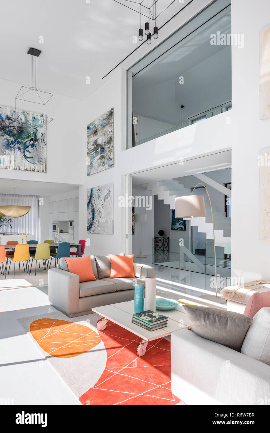 Double height living and dining room with large artworks in new build villa, Quinta do Lago - Stock Image