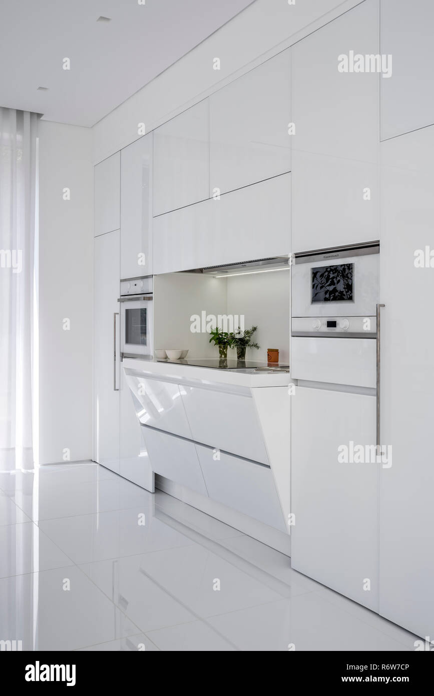 Recessed induction hob in minimalist kitchen of new build villa, Quinta do Lago - Stock Image