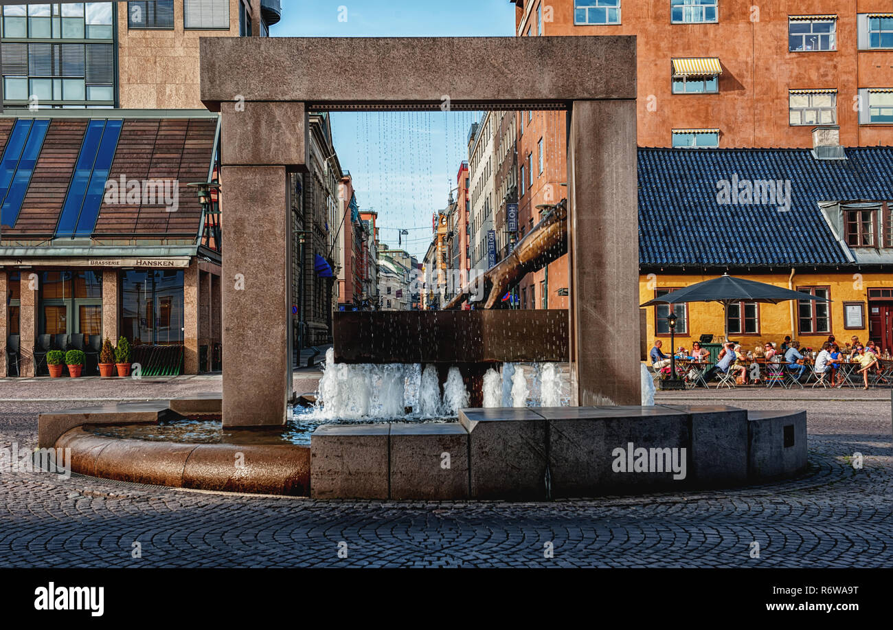 OSLO, NORWAY - JULY 26, 2013: Hansken Fountain Glove with a sculpture of the Hand of King Christian IV, pointing to the location of the new city on Christiania Square Torv in Kvadraturen. editorial - Stock Image