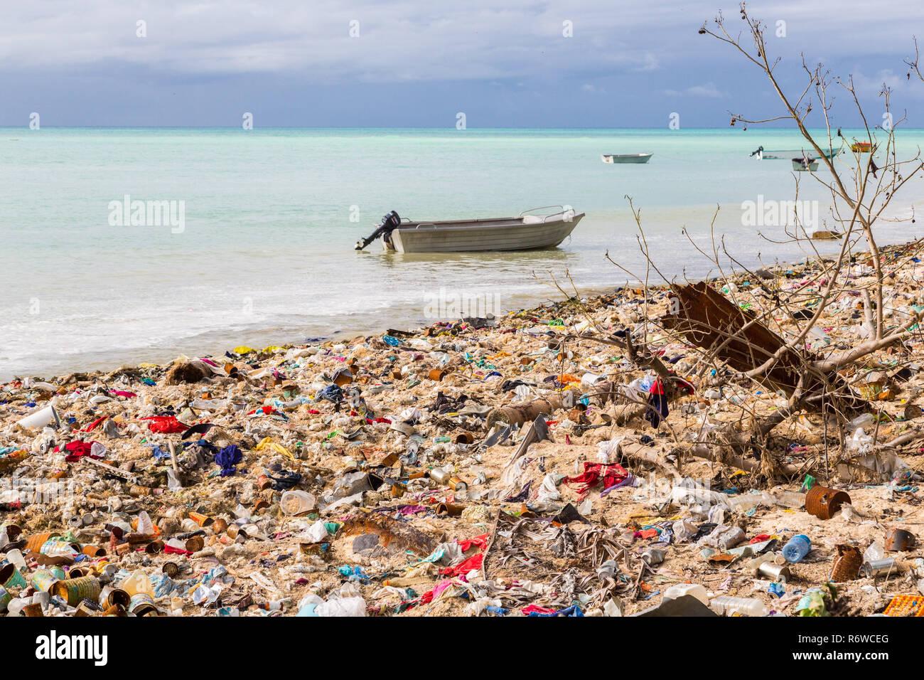Garbage dump, landfill on Micronesian atoll sandy beach, South Tarawa, Kiribati, Oceania, South Pacific Ocean. Ecological, warming, garbage problems. - Stock Image
