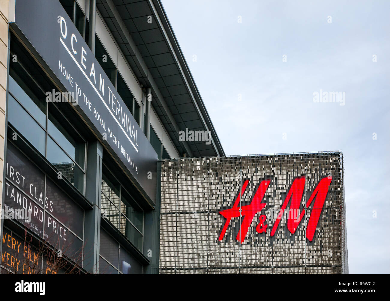 H&M clothing store large logo on building front, Ocean terminal shopping centre, Leith, Edinburgh, Scotland, UK - Stock Image