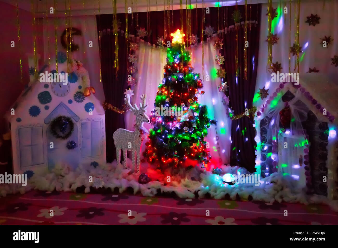 Winter holiday concept, decorated Christmas tree in the interior of photography . New Year background to take photo Stock Photo