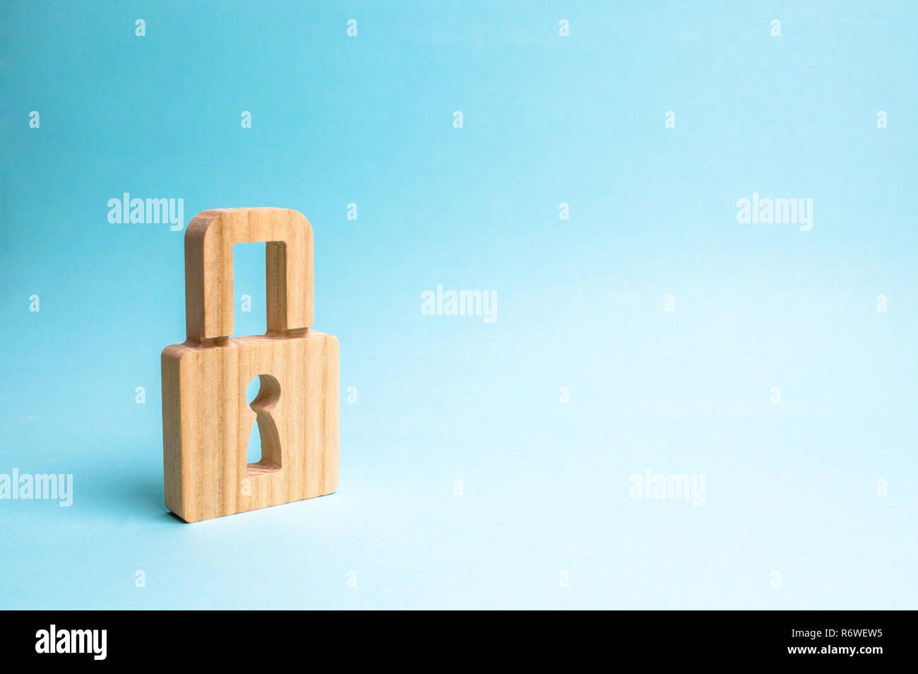 A padlock on a blue background. information safty. concept of the preservation of secrets, information and values. Protection of data and personal inf - Stock Image