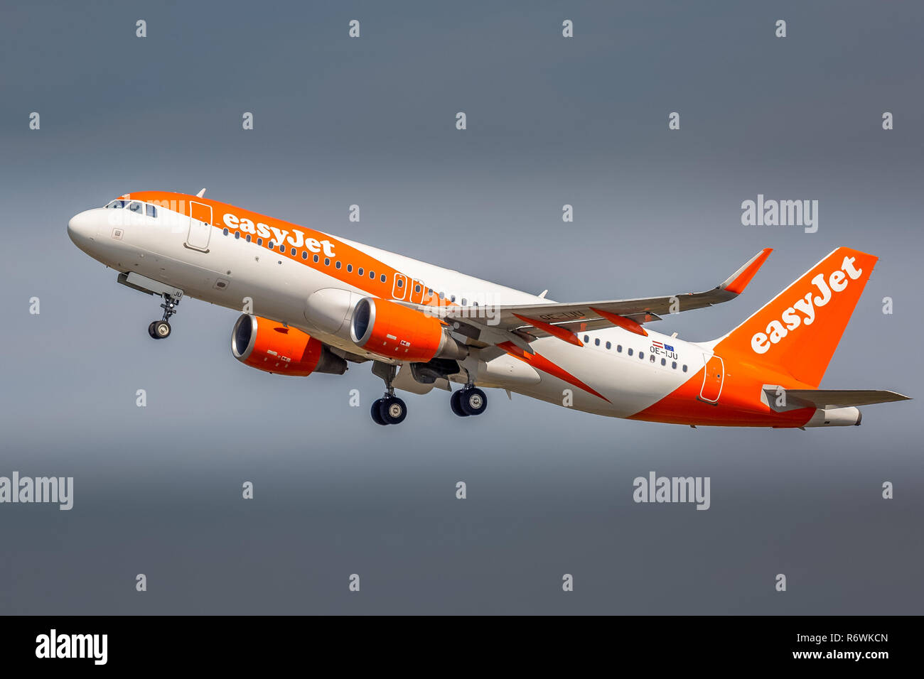 An Easyjet Airbus A320, registration OE-IJU, taking off from manchester Airport in England. - Stock Image