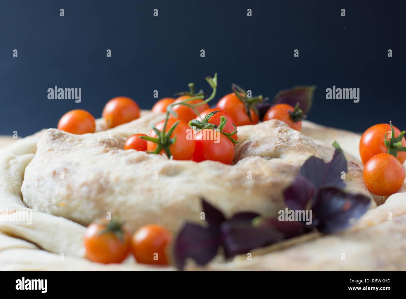 spiral filo pie burek with cherry tomatoes Stock Photo