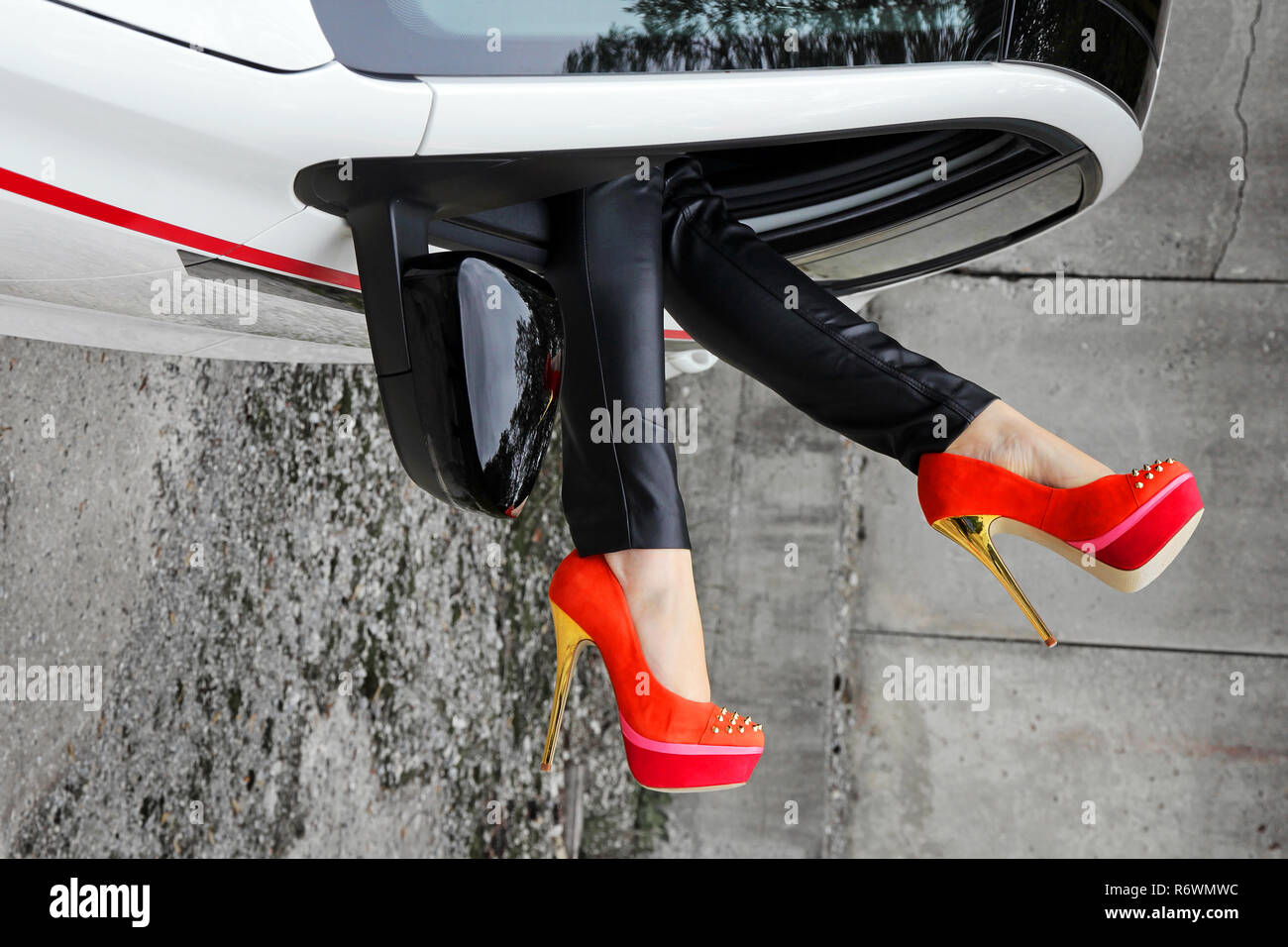 b47a3e4128d a woman stretches her legs out of the window of a car with high heels -