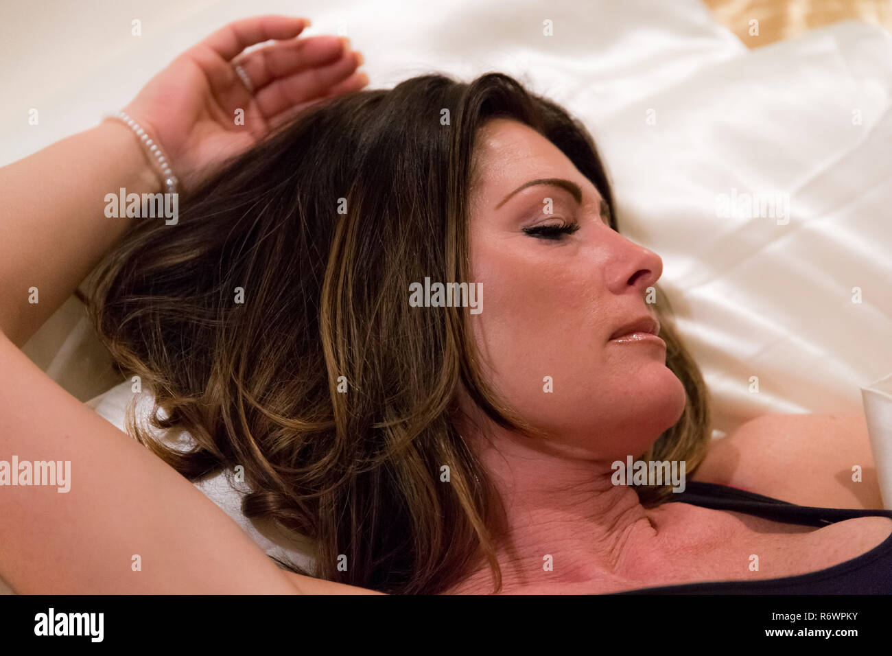 Woman in bed - Stock Image