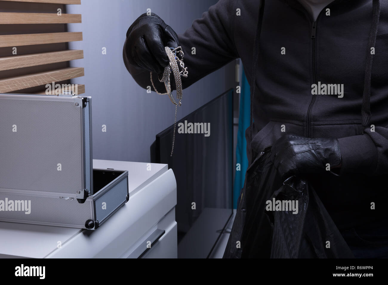 Robber Wearing Gloves Stealing Jewelry Stock Photo