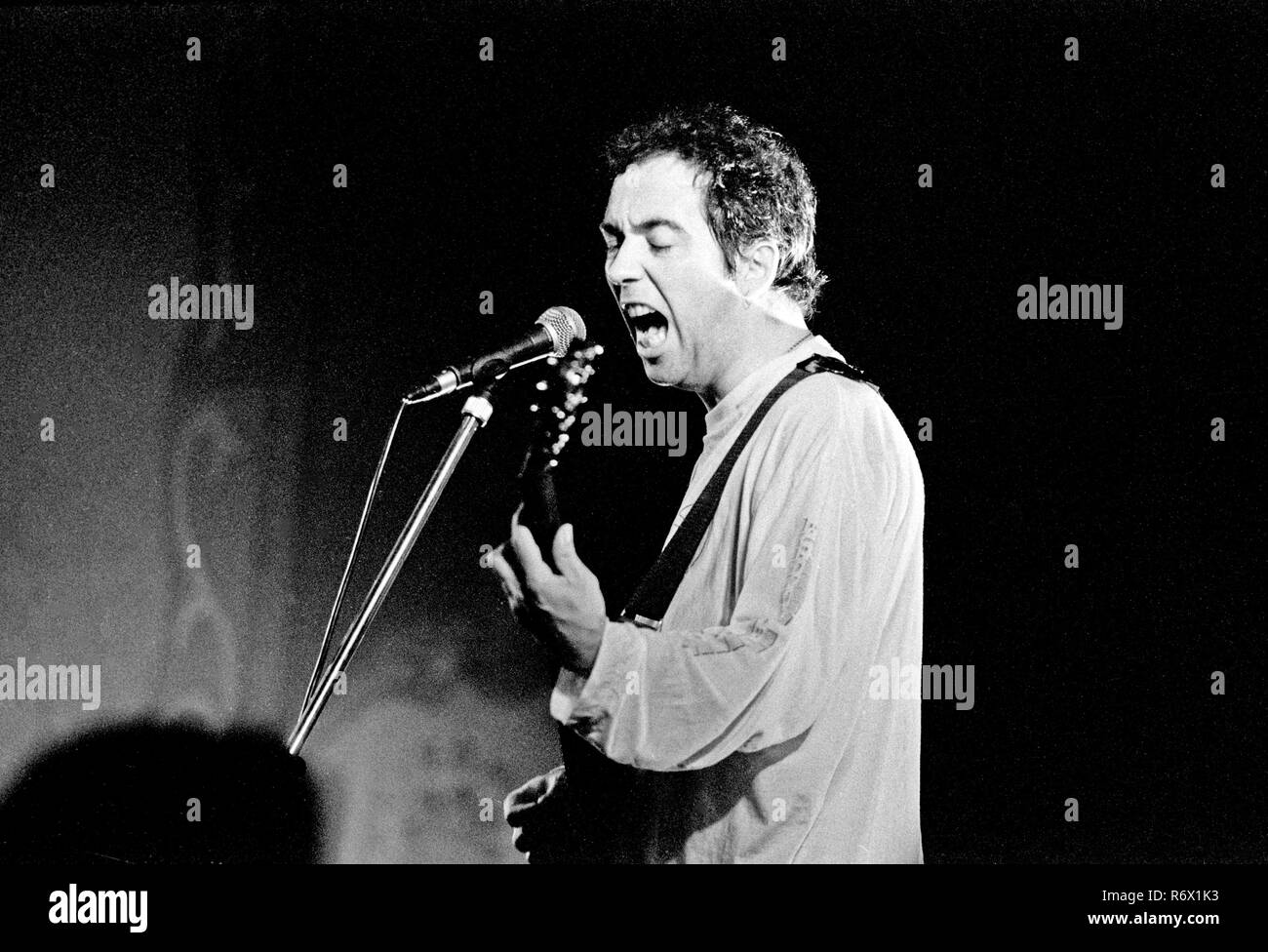 File picture : Pete Shelley performing with The Buzzcocks  at the Patti Pavillion in Swansea on 11th October 1990. He has passed away today (6th December 2018) age 63. - Stock Image