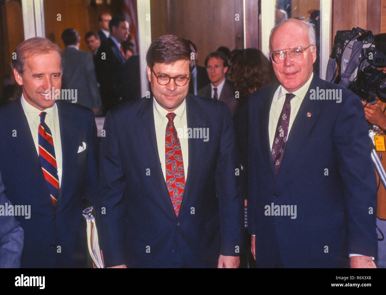 WASHINGTON, DC, USA - NOVEMBER 12, 1991:  William Barr, nominee for U.S. Attorney General, center, Senate Judiciary Committee confirmation hearing. Left Senator Joseph Biden. Right, Senator Patrick Leahy. Stock Photo