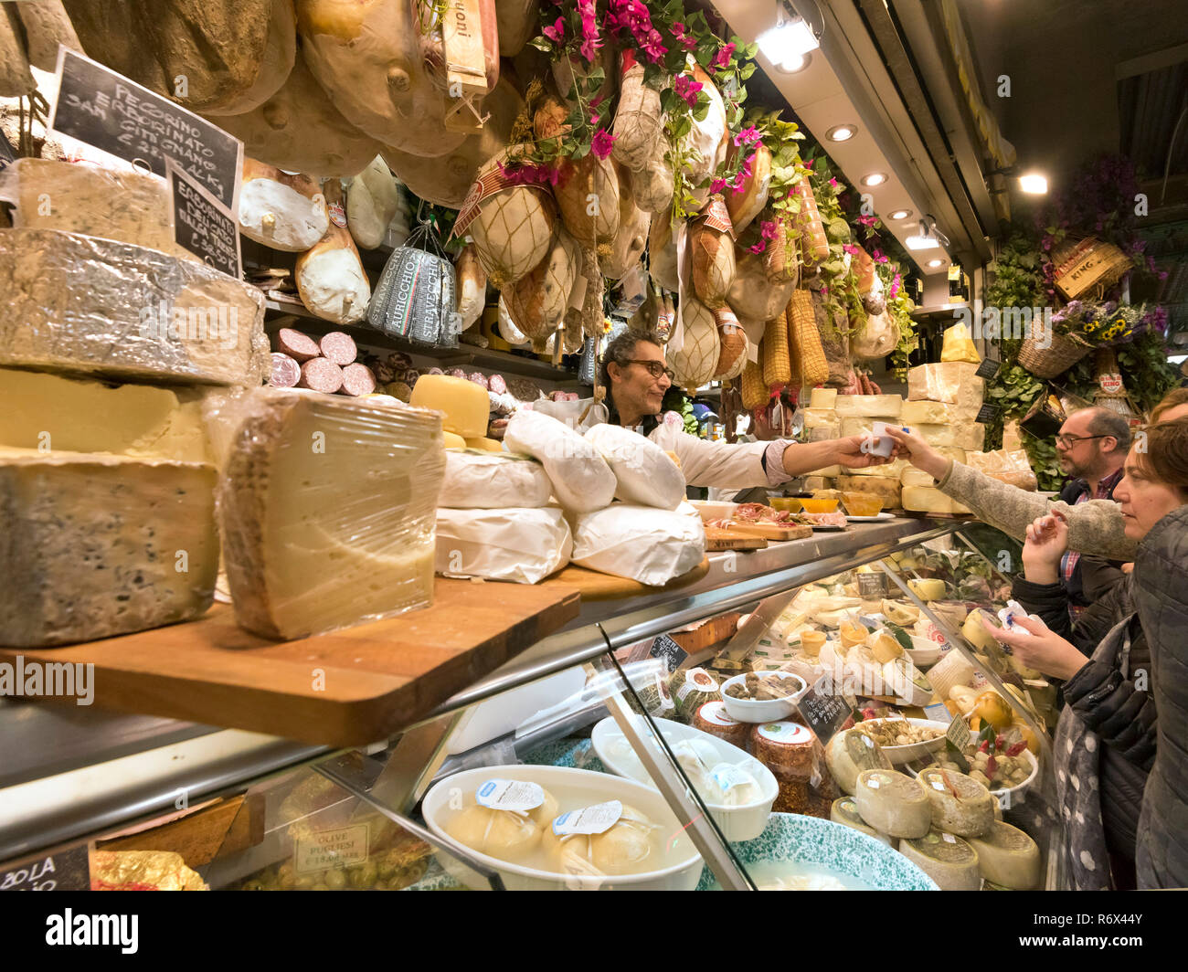 Horizontal portrait of customers inside the Mercato Centrale in Florence, Italy. - Stock Image