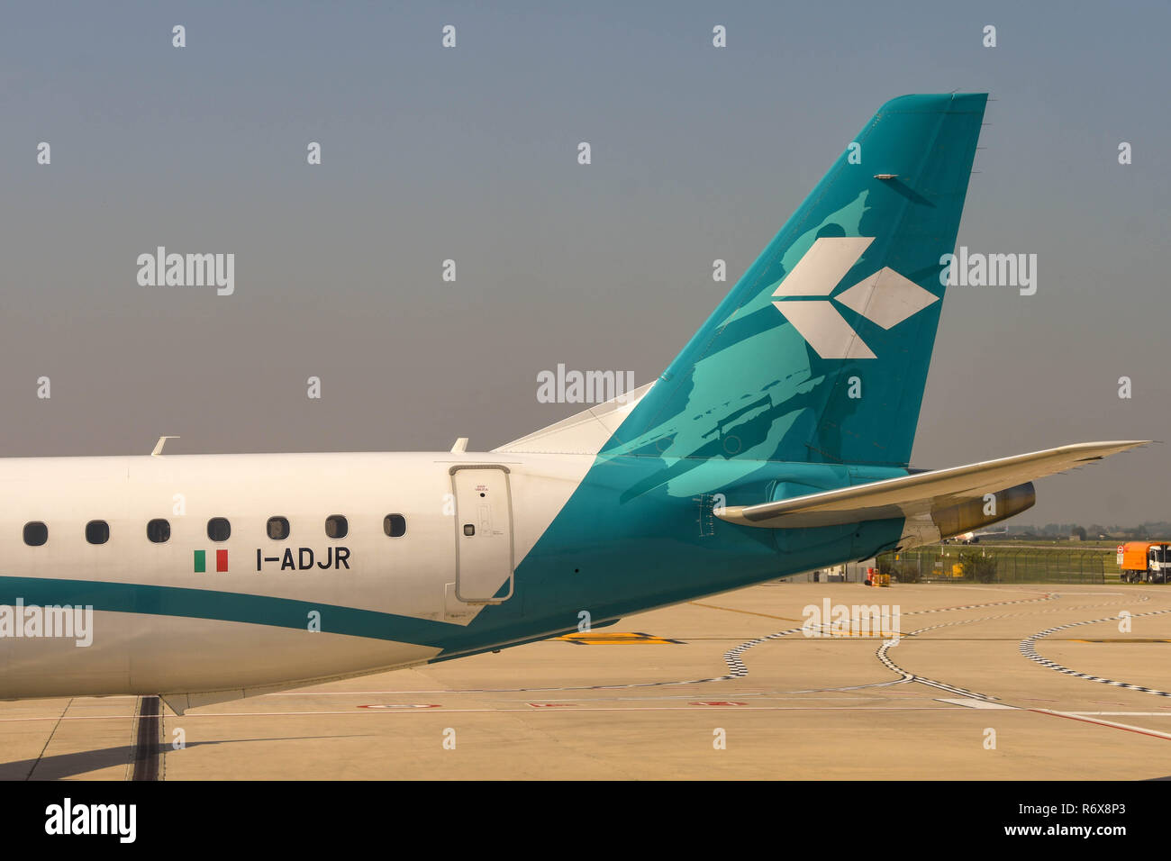 Tali fin of an Air Dolomiti Embraer passenger jet - Stock Image