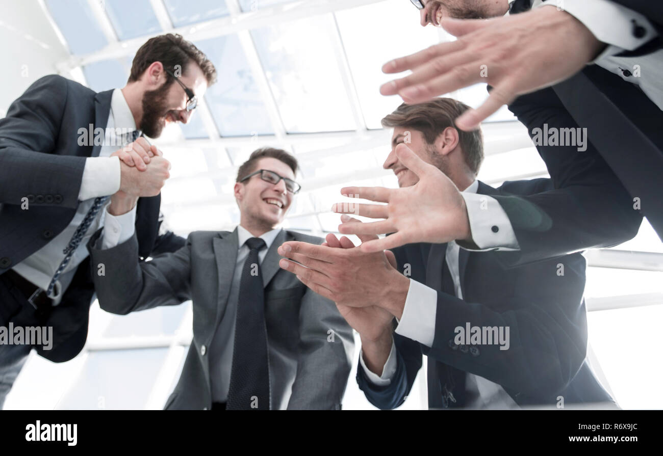 bottom view.a group of business people demonstrating their succe - Stock Image