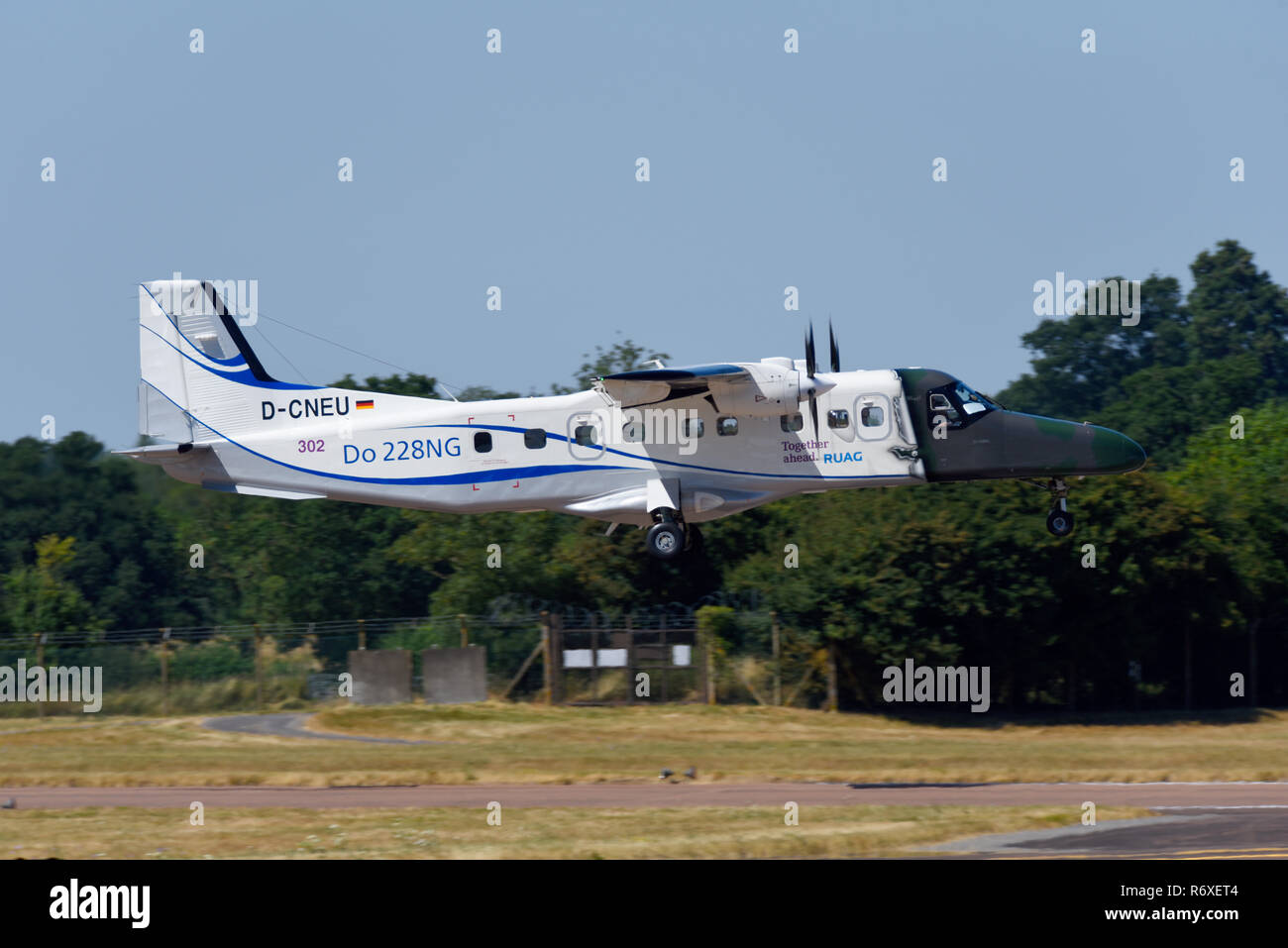 German Navy Dornier Do 228NG landing at Royal International Air Tattoo, RIAT, RAF Fairford airshow. RUAG together ahead. D-CNEU - Stock Image