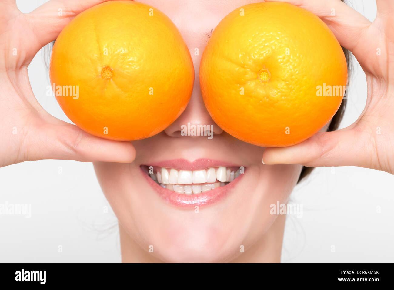 Beautiful girl with juicy orange Stock Photo