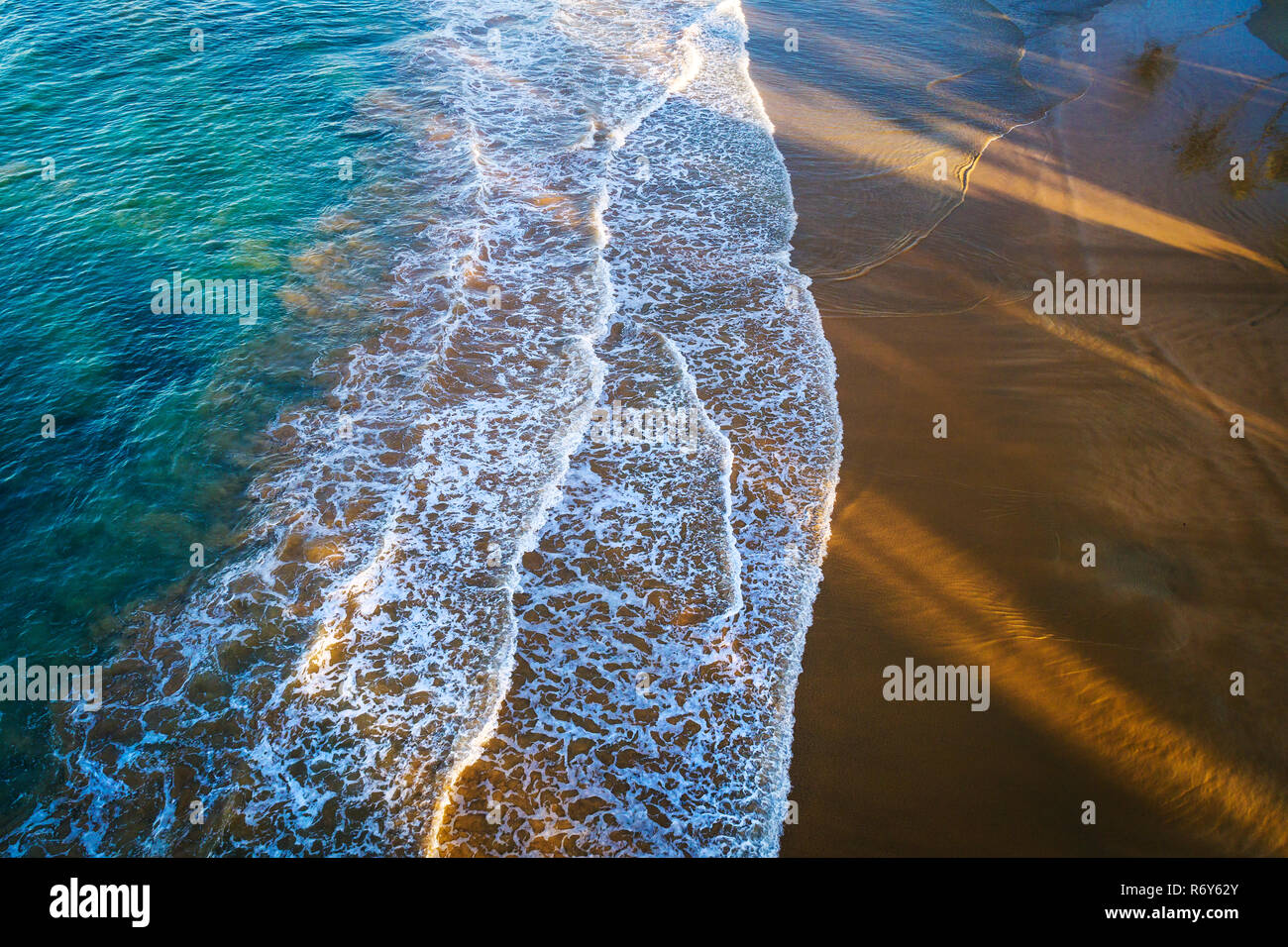 Sea sand and surf aerial photo - Stock Image