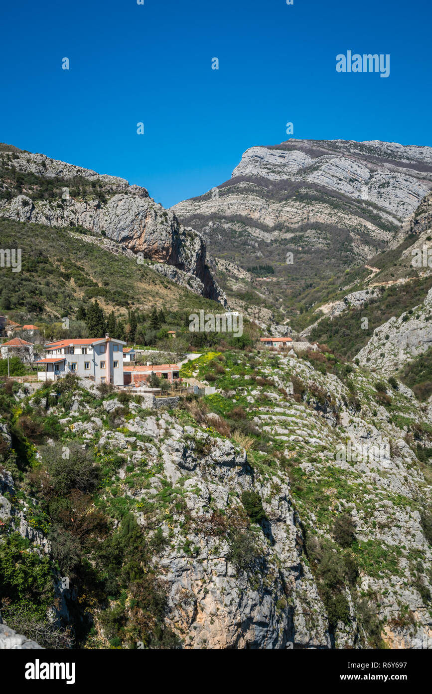 Homes on the cliff in Montenegro Stock Photo