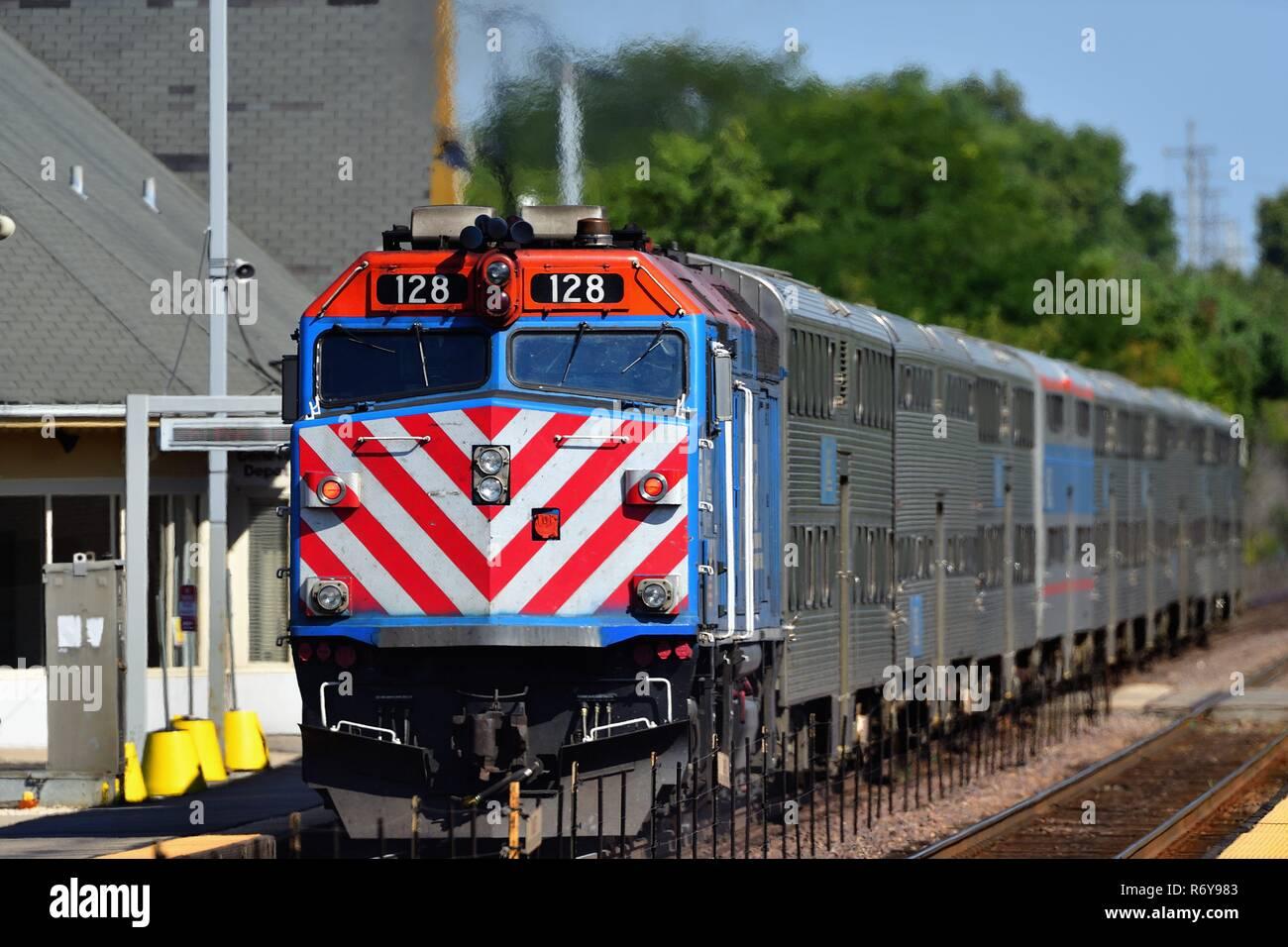 Geneva, Illinois, USA. An inbound Metra commuter train destinved for Chicago departing the Geneva, Illinois station. - Stock Image