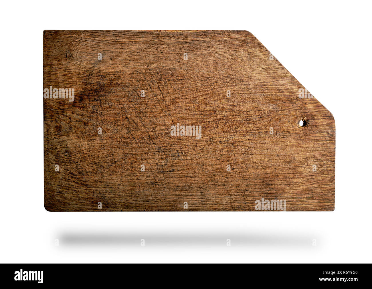 rectangular brown old cutting board with bevelled corner - Stock Image