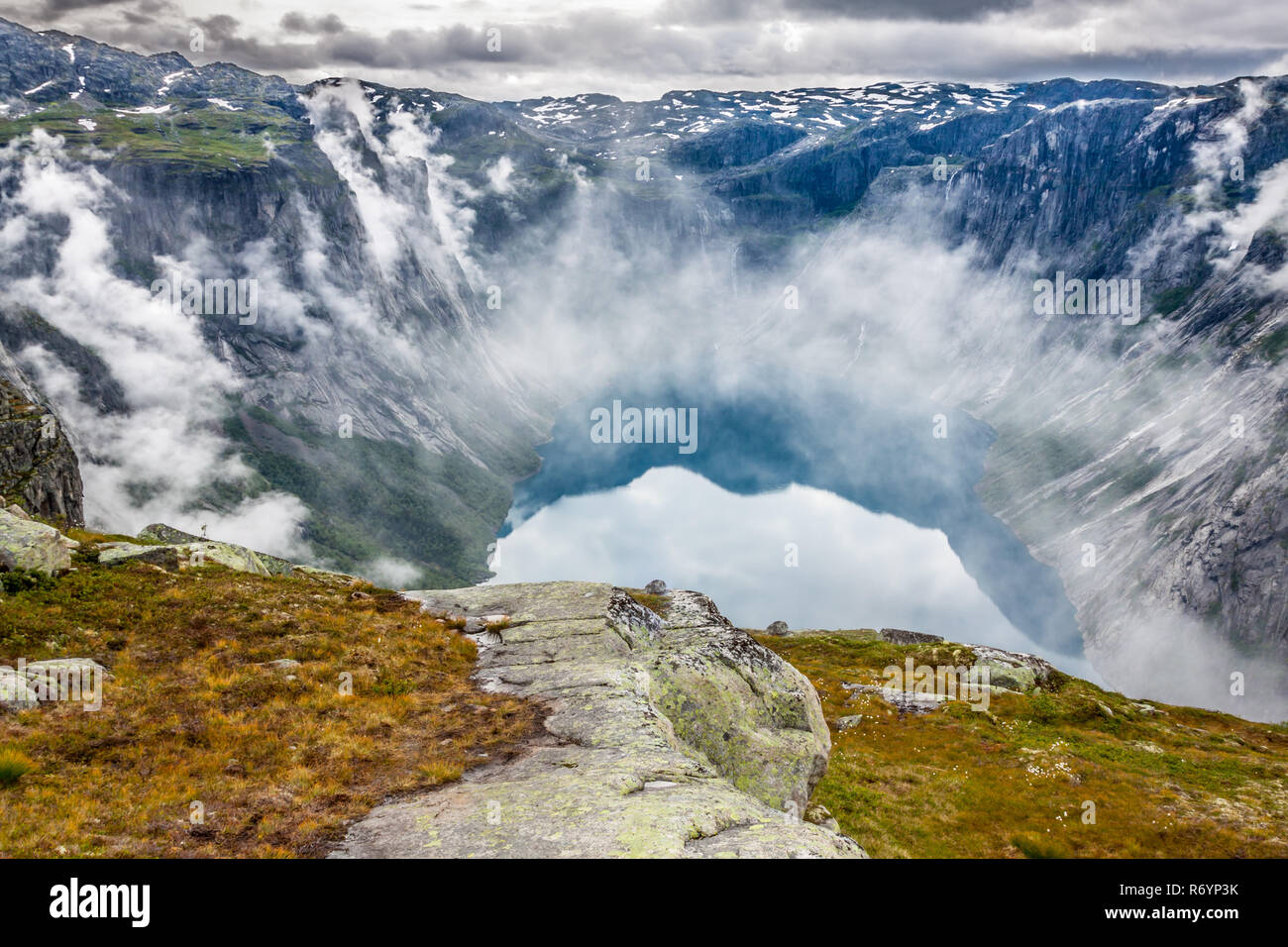 beautiful norwegian landscape with mountains on the way to trolltunga - Stock Image
