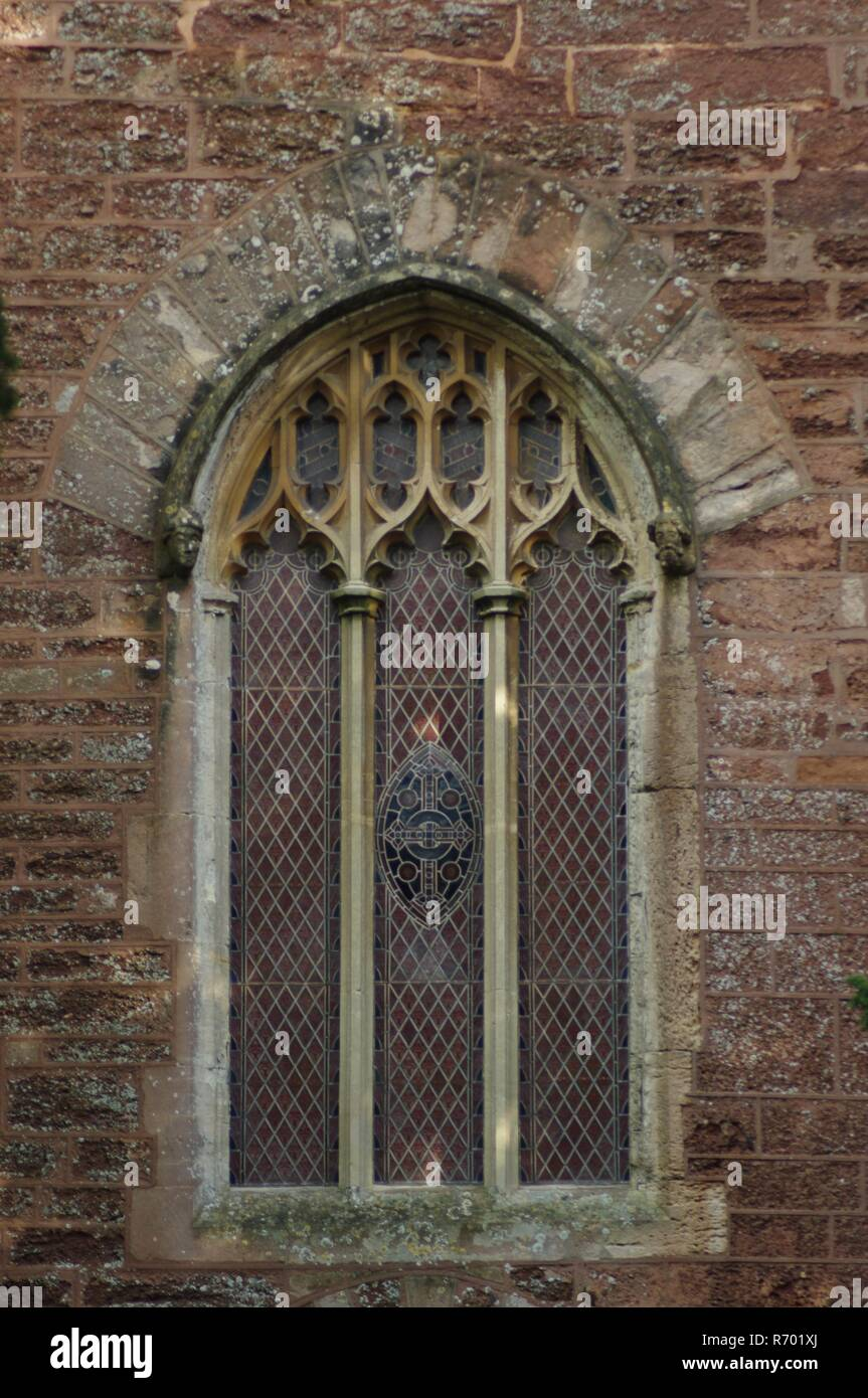 St Clement's Parish Church, Powderham, Devon, UK. Gothic Window in Red Tower, Medieval Ecclesiastical Architecture. - Stock Image
