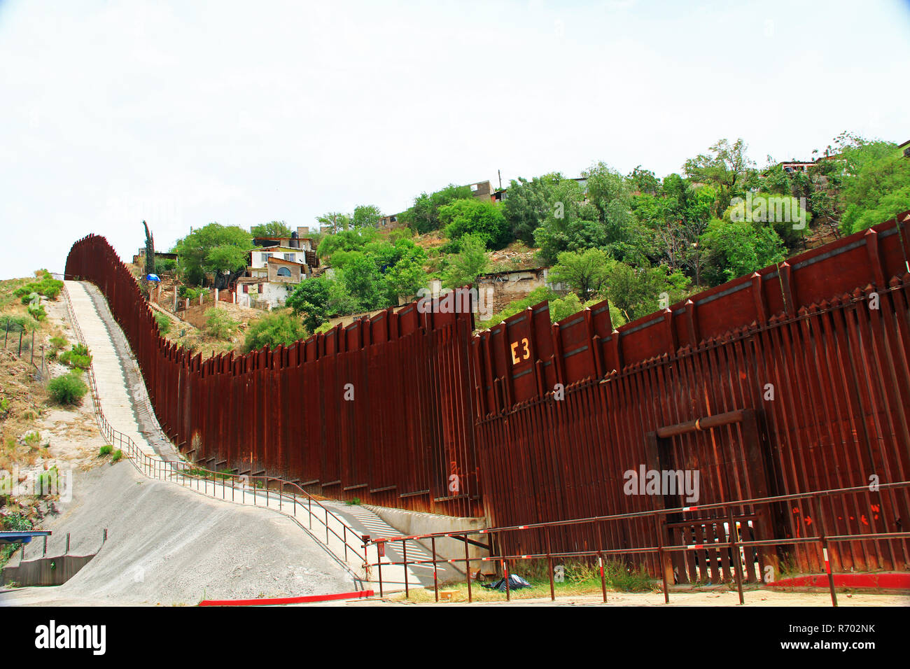 Border Fence Separating the US from Mexico in Nogales, Arizona Stock Photo