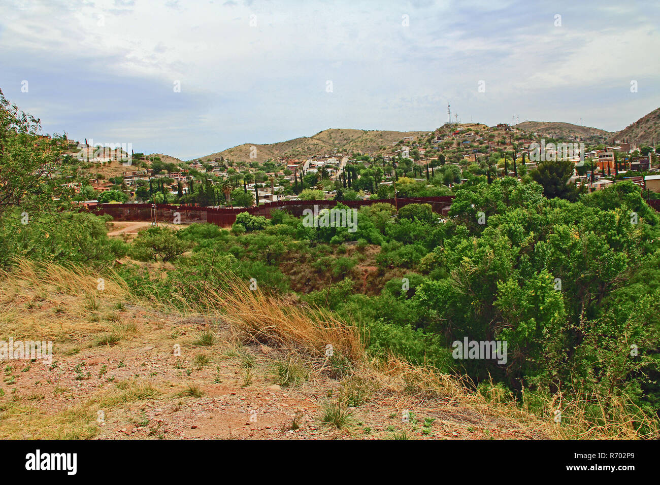 Border Fence Separating the US from Mexico Near Nogales, Arizona Stock Photo