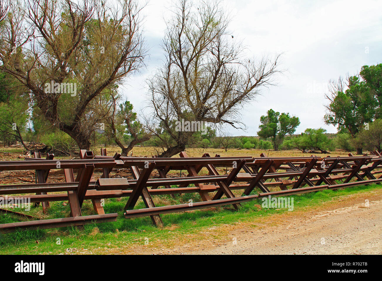 River Border Fence Separating the US from Mexico Near Nogales, Arizona Stock Photo