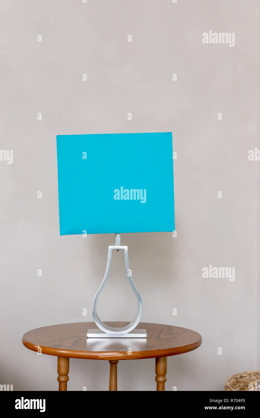 Blue lampshade isolated on beige wall background table lamp in turquoise and gray colours modern living room interior of modern house detail living room