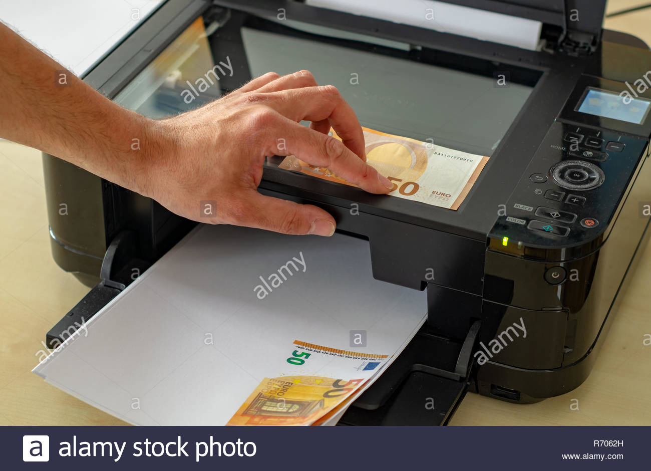 himself printing his counterfeit money Stock Photo