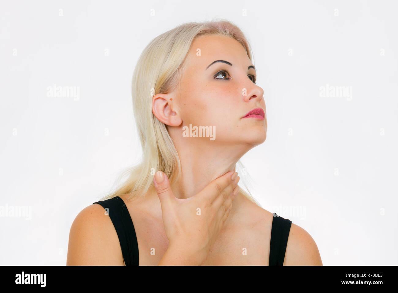Face exercise turkey wattle massage, woman massages her neck - Stock Image