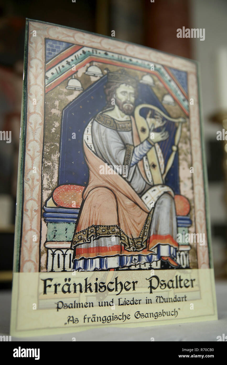 "Lichtenau, Germany. 06th Dec, 2018. The Church Dialect Songbook ""Franconian Psalter - Psalms and Songs in Dialect - As fränggische Gsangsbuch"" is in the Trinity Church. The special hymnbook for Franconia contains not only the Franconian ""Our Father"", but a total of 23 biblical psalms and 44 songs on 80 pages. Including dialect versions of well-known Christmas songs. (to dpa-Korr: ""Vadder unser - Franken gets church dialect songbook"" from 07.12.2018) Credit: Daniel Karmann/dpa/Alamy Live News Stock Photo"