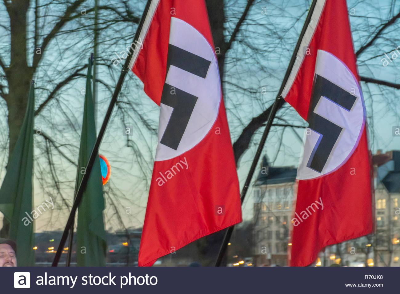 Helsinki, Finland. 6th Dec 2018. Banned Neo Nazi Organisation Nordic Resistance Movement waving Nazi flags at demonstration on Independecce Day of Finland Credit: Pekka Liukkonen/Alamy Live News Stock Photo